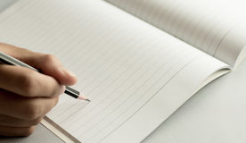 Pencil write on notebook Stock Photography