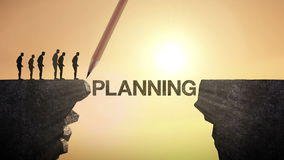 Pencil write 'PLANNING', connecting the cliff. Businessman crossing the cliff, business concept.