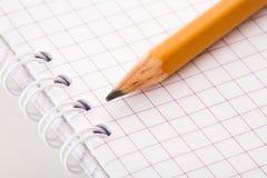 Pencil and writing-book. Close-up royalty free stock photos