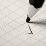 Pencil writing a mark Stock Photography
