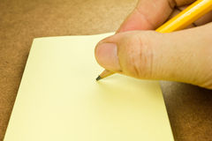 Pencil writing on note paper Royalty Free Stock Photos