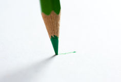 Pencil writing on paper Royalty Free Stock Photos