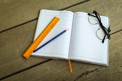 Pencil, yellow ruler for blank notebook write your note and gl Royalty Free Stock Image
