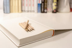 Penciles on a blank note book Royalty Free Stock Photo