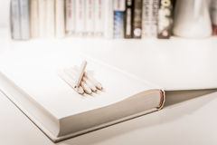 Penciles on a blank note book Royalty Free Stock Image