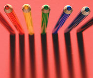 Pencils #1. Pencils standing erect on red background Royalty Free Stock Images