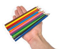 Pencils. The set of multi-coloured pencils is placed on a hand Stock Images