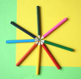 Pencils. With different colors in font of yellow and green background stock photo
