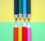 Pencils. With different colors in font of yellow and green background stock image
