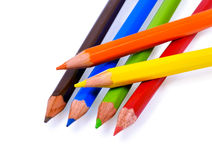 Pencils. Six color pencils. Focus on a yellow pencil. Isolated on white Royalty Free Stock Photography