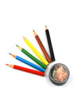 Pencils. Six  coloured pencils and sharpener isolated over white background Royalty Free Stock Image