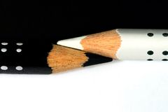 Pencils. White and black dotted pencils royalty free stock photo