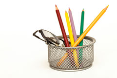 Pencils. And glasses are in a glass cage Stock Images