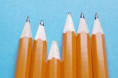 Pencils. Blunt pencil struggling to keep up with contemporaries. A concept for students with learning difficulties in education Royalty Free Stock Photography