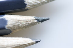 Pencils. Gray pencils macro on neutral gray backgound Royalty Free Stock Photo