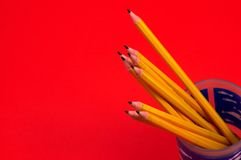 Pencils. On red, space for messages Stock Photos