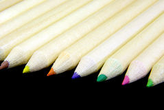 Pencils align 2. Detail view of pencils over black background Royalty Free Stock Photo