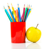 Pencils and apple. Royalty Free Stock Images