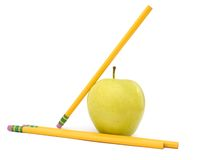 Pencils and apple Royalty Free Stock Photos