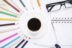 Pencils around coffee cup Royalty Free Stock Image
