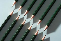 Pencils arrranged to cause a zigzag pattern Royalty Free Stock Photography