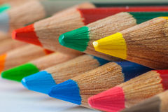 Pencils background. Macro row of neon colored pencils Royalty Free Stock Photography