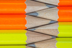 Pencils background. Macro Row of neon colored pencils Stock Images