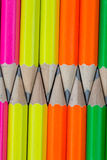 Pencils background. Macro Row of neon colored pencils Royalty Free Stock Image