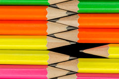 Pencils background. Macro Row of neon colored pencils Stock Photo