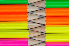 Pencils background. Macro Row of neon colored pencils Royalty Free Stock Photos