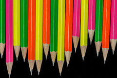 Pencils background. Row of neon colored pencils Royalty Free Stock Images