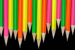 Pencils background. Row of neon colored pencils Royalty Free Stock Image