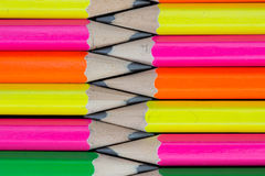 Pencils background. Row of neon colored pencils Stock Photos
