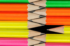 Pencils background. Row of neon colored pencils Royalty Free Stock Photography