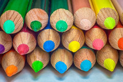 Pencils background. Row of variety of colored pencils Stock Images