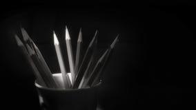 Pencils on black background, black and white idea Stock Photos