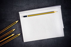 Pencils And Blank Notepad Page Royalty Free Stock Photos