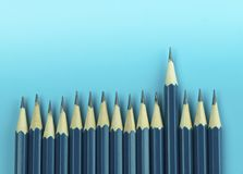 Pencils on blue background, concept in leader Royalty Free Stock Photos
