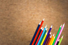 Pencils on blurry cork background Stock Image