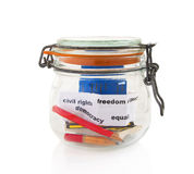 Pencils and books in glass jar Stock Photos