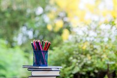 Pencils and books are placed on wooden floors. royalty free stock images