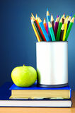 Pencils and books on the table Royalty Free Stock Image