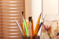 Pencils and brushes Stock Photos