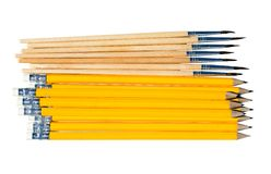 Pencils and brushes isolated on white. Background Stock Images