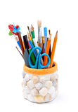 Pencils, brushes, plastic knife, scissors in handmade pencil-box Royalty Free Stock Photography