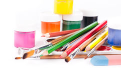 Pencils and brushes on a white Stock Images