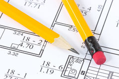Pencils on the building plan. Two yellow pencils on the building plan Stock Photo