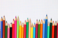Pencils and checked notebook Royalty Free Stock Photos