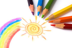 Pencils and child drawing. Colored pencils and child drawing. studio shot royalty free stock photos