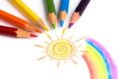 Pencils and child drawing. Colored pencils and child drawing. studio shot royalty free stock images